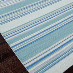 The Jaipur Coastal Shores Kiawah rug embodies island living in ocean-inspired hues. Turquoise and gray stripes demand the focus, in a classic-meets-contemporary style. The flat-woven wool proves both soft and durable, a perfect addition to family areas and relaxed gathering spaces. Sizes: 2ft W x 3ft L, 2ft-6in W x 8ft L, 4ft W x 6ft L, 5ft W x 8ft L, 8ft W x 10ft L, 9ft W x 12ft L, 10ft W x 14ft L; Colors: Harbor Gray & Dusty Turquoise; Material: 100% wool, Flat weave; Care Instructions:...