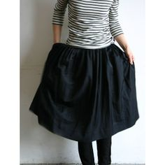 the black skirt with stripes t-shirt...