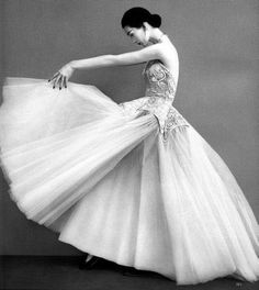 Dovima in Balenciaga's gown of embroidered champagne satin and pale pink tulle photographed by Richard Avedon, winter 1950