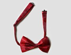 HARALD'S Deep red bow tie- This exquisitely hand crafted red bow tie matches especially well with reds, maroon and greys.