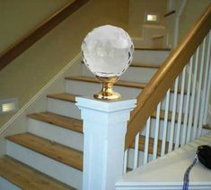 This glass finial tops a white newel post to start the handrail system on this staircase, mixed materials add a stylish dimension to this balustrade #staircase #handrail #finial #homediy #renovation