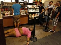The best part of this picture is that no one seems bothered by the large man in the stretchy pink outfit passed out on the floor...