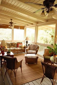 I like the painted ceiling on this porch.  It really brightens things up. Need to try this on our porch.