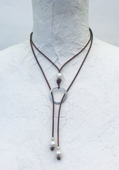 Circles can be an endless design element creating all kinds of possibilities. Criss cross the ends thru the circle for one look. Wear as a lariat to create anot