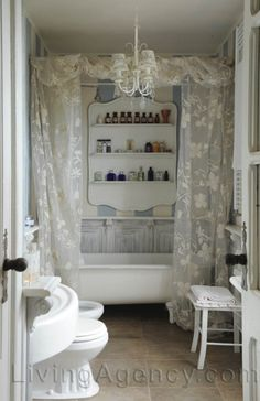Great idea for shampoo and soaps. Love the striped wall & the whitewashed panels behind the tub. Especially love the creative storage that makes it almost look like art. Cottage Curtains, Lace Curtains, Curtain Designs, Farmhouse Chic, Shabby Chic Homes, Beautiful Bathrooms, Home Interior, Interior Design, Decoration