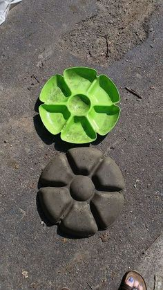 Garden flower stone. Put a hook in to hang on wall, or a hole through it to put on stake? Now to find one of these vege & dip trays. Dollar store?