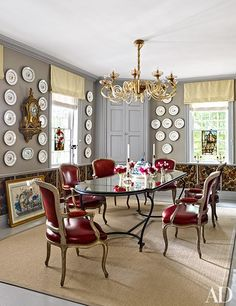 In the dining room, a Venini chandelier hangs above a vintage French table | archdigest.com