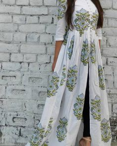 This summer season try the trendy Cape Kurtis. Know the various Cape Style Kurti Designs and patterns that are perfect for any casual occasion. Indian Attire, Indian Wear, Hijab Fashion, Fashion Dresses, Muslim Fashion, Fashion Hub, Women's Dresses, Dresses Online, Fashion News