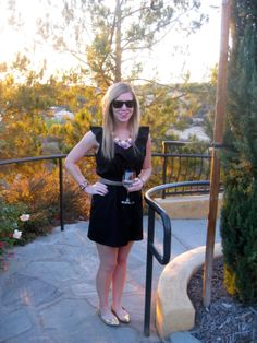 Black dress, metallic gold belt and flats, fringe necklace, ray bans. Wine tasting in Temecula, CA