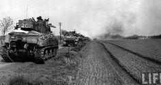 Bougainville (?) 1944, a column of Sherman tanks