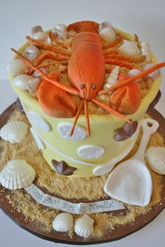 this lobster topped sand bucket was the center of a summer birthday celebration. We hand crafted the lobster from sugar paste and the beach bucket is entirely cake. Chocolate shells are scattered throughout. Fondant Cakes, Cupcake Cakes, Cupcakes, Food Cakes, Custom Birthday Cakes, Custom Cakes, Sand Bucket Cake, Beach Bucket, Lobster Cake