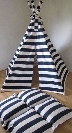 Navy Blue Stripe Teepee ($185)    Crisp navy and white stripes give this neat little teepee a nautical vibe. It comes preassembled, so setup is easy as 1-2-3!