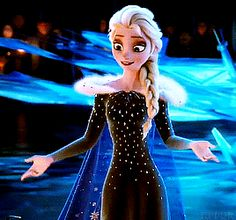Elsa using her magic to make the Christmas tree.