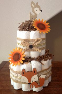 This listing is for a 2 tier forest animals themed diaper cake. This diaper cake is made with 26 size 1 diapers. This listing can be customized to match your theme/colors. Convo me for a custom order. All items are made in a pet free / smoke free environment.