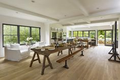 In the kitchen there's an antique wooden trestle table which his team restored and refinished.