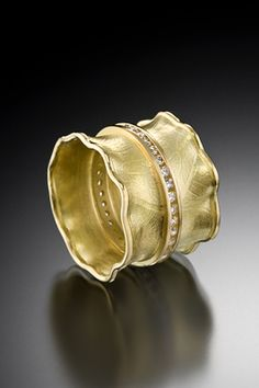 Ring   Barbara Heinrich. 18kt yellow gold with channel set diamond center band, 0.54 cttw, and polished rims.