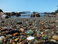 Moonstone Beach, Cambria, CA. Bring a small container because you can spend HOURS picking thru the beautiful rocks on the beach. Not a lot of sand here but LOTS of pebbles buffed by the ocean. Jasper, moonstones, sea glass, etc.