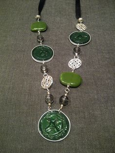 eco necklace with green nespresso capsules