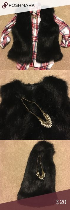 Black Faux Fur Vest  Very fun vest. Great for the holidays or just if you want alittle edgy in your outfit. Cute with jeans and boots. SFH. Thanks Mixitup Jackets & Coats Vests