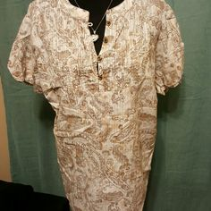 Casual short sleeve peasant shirt Cream and brown paisley pattern with cap sleeves and pleated detailing along bust line. Looks great with a jean jacket and boots! In excellent condition, only worn once! Maurices Tops Blouses