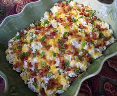 Ingredients 1 head cauliflower, boiled and mashed 1/2 cup sour cream 1/4 cup bacon bits 1/2 cup shredded Cheddar cheese 1 teaspoon dry ranch salad dressing