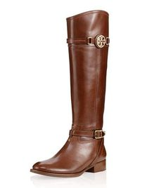 A classic equestrian style, such as the Calista Riding Boot, is a wardrobe must-have for Fall 2012! The rich leather lends a sophisticated, structured shape, with straps accented by gold hardware and finished with a logo medallion at the calf. Wear it with jeans and skirts, long or short, for a polished look. Also available in black and taupe now at Pumpz & Company, Galleria, Edina, 952.926.2252