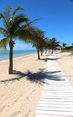 Stroll along the boardwalk on Long Bay Beach, Turks & Caicos
