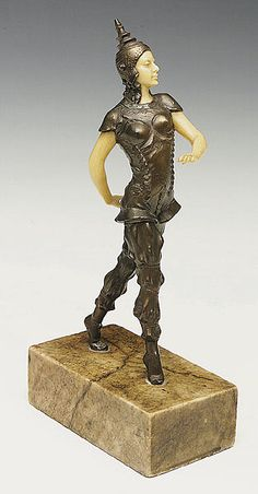 A Celluloid and Bronze-Patinated Metal Art Deco Figure of a Striding Dancer in Siamese Costume, c. 1925,