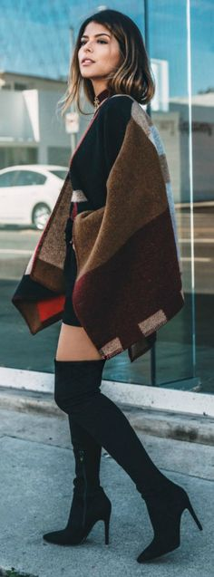 blanket coat trend + never been hotter + Pam Hetlinger + block print piece + thigh high black boots + sexy and sophisticated style    Coat: Burberry.