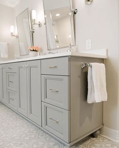 "Cabinet paint color is"" Ever Classic"" from Pratt and Lambert.  Perfect mid-tone warm gray."