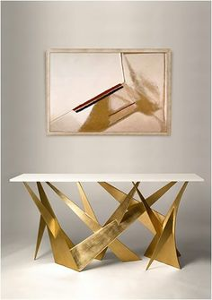 A gold leaf finish will contribute towards a sculpted and raw look, which can appeal to a very clean space.