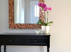 Customize a framed mirror by adhering pennies along the edge. Copper decor for cheap!