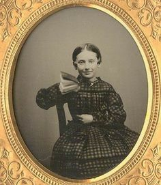 """""""Thankyou, I'd love to read your favorite book."""" How can you not appreciate this cutie from the 1850s? Her dress has double gigot sleeves. (I found her on Faustine Derouet-Avrillon's site.)"""