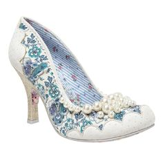 Feel pretty with Pearly Girly! This heel features a blue floral print with light blue scalloped contrast fabric. The heel is adorned with a blue and white spotted fabric, and a cluster of white pearls glimmer along the throat line.