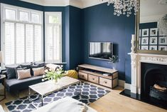 Shutters And Comfy Sofas - Victorian Villa Sitting Room Painted In Farrow & Ball Stifkey Blue