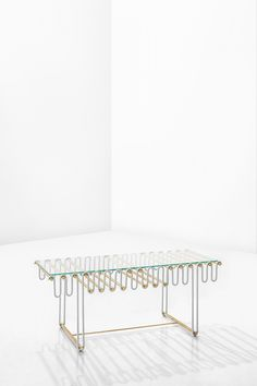 PALERMODIMORESTUDIO, PROGETTO VERANDE2016Low table with structure in painted metal and oxidised brass;top in tempered glass.w.64 X d.32 X h.30 cm