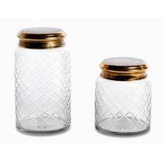 Szklany pojemnik, zamykany pokrywką z mosiądzu.  http://hinteriors.pl/akcesoria/111-szklany-pojemnik.html
