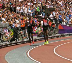 Summer Olympics - London 2012 - Men's 800m - Final: Lap of honour - Victory Lap -- World Record holder, breaker, holder: David Rudisha, and, bronze-medallist, 17-year-old Kenyan Timothy Kitum.