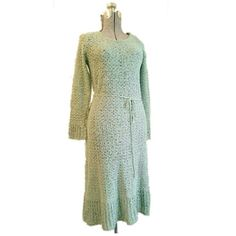 Vintage PALLAS Irish Linen Dress mint green Large This beautiful vintage sweater dress is made of sea foam green  hand-loomed Irish linen.  Brand: Pallas Size: Large True vintage, from the 1970s. Long sleeves. Includes tie belt.  Gorgeous mint seafoam pale green color nubby texture. Open knit, recommended wear with a slip underneath. The material is so nice feeling- medium weight and slightly springy. Hits just below the knee. Excellent condition. From a smoke free home. Vintage Dresses