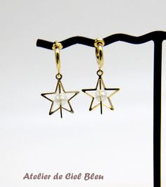 Gold Star Clip on Earrings by AtelierdeCielBleu