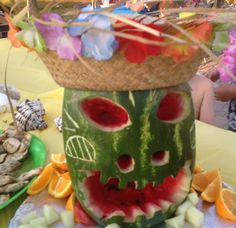 Retirement Surprise Hawaiian Party for my mother in law. my brother in law Mike carved a Watermelon to put on the food table.  We put a hat on it & looked great !