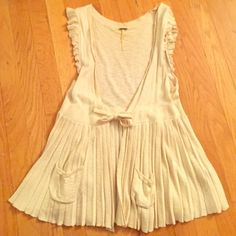 Frilly feminine Free People vest Cream colored boho chic Free People vest. Cinch tie waist. Pleated peplum with pockets. Very soft and adds a bit of femininity to any outfit Free People Tops