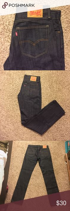 Levis 511 jeans Brand new never worn. Levis 511's 36x36. Slim fit through thigh, tapered ankle. Rigid Dragon color, perfect dark wash denim. Levi's Jeans Slim Straight