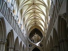In Wells Cathedral, the horizontal is emphasised, rather than the vertical. The nave terminates abruptly in a structure known as St Andrew's Cross, which was inserted to support the tower.