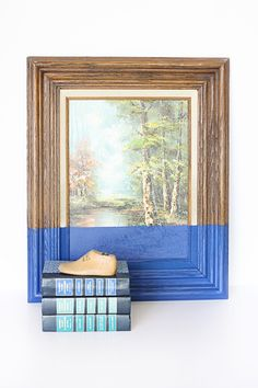 If the painting is ugly enough to ruin it by dipping, why would you put it on your wall?  If you would read the books, why turn them into a shelf?  If you wouldn't, why display them?