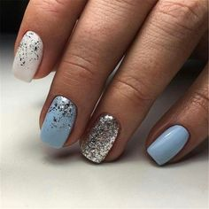"""If you're unfamiliar with nail trends and you hear the words """"coffin nails,"""" what comes to mind? It's not nails with coffins drawn on them. It's long nails with a square tip, and the look has. Blue And Silver Nails, Light Blue Nails, Blue Glitter Nails, Silver Glitter, Light Blue Nail Designs, Blue Gel Nails, Silver Sparkle Nails, Pastel Blue Nails, Glitter Uggs"""