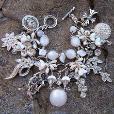 bracelet using a collection of dangle earrings.  Looks frosty. For all those earrings that don't have a match