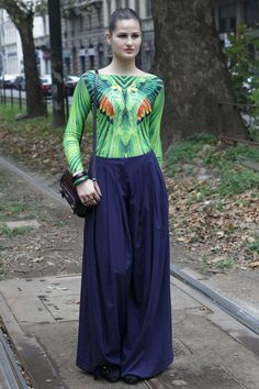 A great contrast of super wide palazzo pants and a skintight, tropical bird body