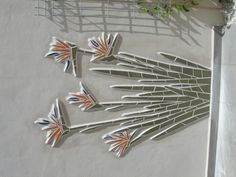 Mosaic of Bird of Paradise flowers - directly applied to wall. 1mtr+ high turns right way up when you open