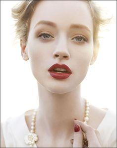Beautiful, muted makeup, dark red lip.